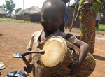 Child with a talking drum