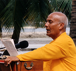 Sri Chinmoy performing his own compositions accompanying himself on harmonium.